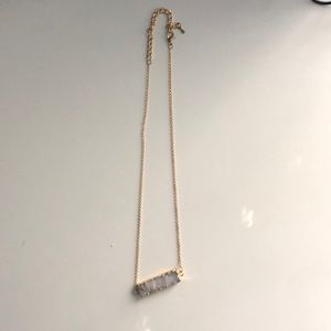 Gold necklace with crystal plate